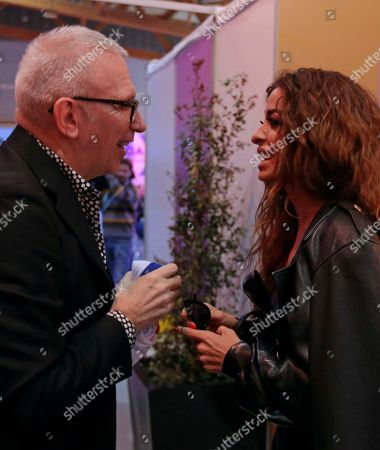 Contestant Eleni Foureira from Cyprus speaks backstage to French fashion designer Jean-Paul Gaultier in Lisbon, Portugal, before the Eurovision Song Contest grand final