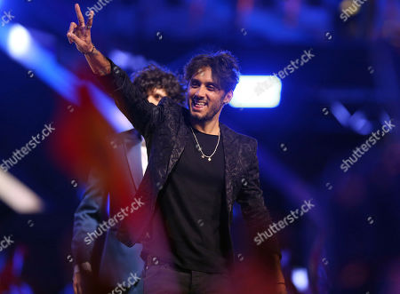 Ermal Meta and Fabrizio Moro from Italy gesture as they arrive on stage in Lisbon, Portugal, before the Eurovision Song Contest grand final