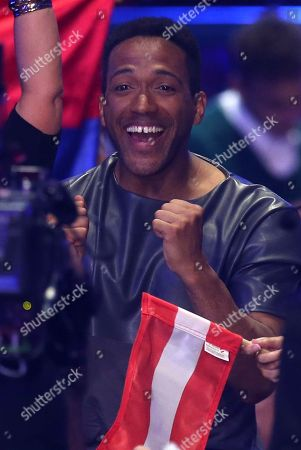 Stock Image of Cesar Sampson from Austria celebrates when a voting is announced in Lisbon, Portugal, during the Eurovision Song Contest grand final