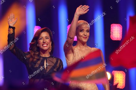 Portuguese singers Ana Moura, left, and Mariza wave after performing in Lisbon, Portugal, during the Eurovision Song Contest grand final