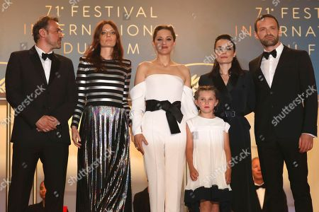 Stephane Rideau, Amelie Daure, Marion Cotillard, Ayline Aksoy-Etaix, Vanessa Filho, Alban Lenoir. Actor Stephane Rideau, from left, actress Amelie Daure, actress Marion Cotillard, actress Ayline Aksoy-Etaix, director Vanessa Filho and actor Alban Lenoir from the film 'Angel Face' pose for photographers upon arrival at the premiere of the film '3 Faces' at the 71st international film festival, Cannes, southern France
