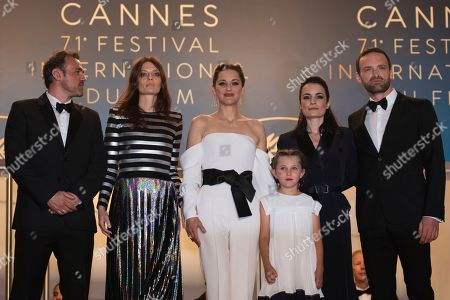 Alban Lenoir, Vanessa Filho, Ayline Aksoy-Etaix, Marion Cotillard, Amelie Daure, Stephane Rideau. Actor Stephane Rideau, from left, actress Amelie Daure, actress Marion Cotillard, actress Ayline Aksoy-Etaix, director Vanessa Filho and actor Alban Lenoir from the film 'Angel Face' pose for photographers upon arrival at the premiere of the film '3 Faces' at the 71st international film festival, Cannes, southern France