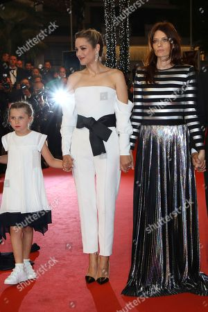Ayline Aksoy-Etaix, Marion Cotillard, Amelie Daure. Actresses Ayline Aksoy-Etaix, from left, Marion Cotillard and Amelie Daure from the film 'Angel Face' pose for photographers upon arrival at the premiere of the film '3 Faces' at the 71st international film festival, Cannes, southern France