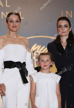 Vanessa Filho, Ayline Aksoy-Etaix, Marion Cotillard. Actress Marion Cotillard, from left, actress Ayline Aksoy-Etaix and director Vanessa Filho from the film 'Angel Face' pose for photographers upon arrival at the premiere of the film '3 Faces' at the 71st international film festival, Cannes, southern France