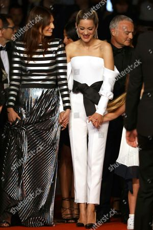 Actresses Amelie Daure, Marion Cotillard from the film 'Angel Face' pose for photographers upon arrival at the premiere of the film '3 Faces' at the 71st international film festival, Cannes, southern France