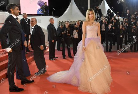 Ramin Bahrani, Sofia Boutella. Director Ramin Bahran, left, and Sofia Boutella pose for photographers upon arrival at the premiere of the film 'Fahrenheit 451' at the 71st international film festival, Cannes, southern France