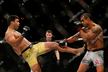 Vitor Belfort, Lyoto Machida. Vitor Belfort, from Brazil, right, and his countryman Lyoto Machida, fight during their UFC middleweight mixed martial arts bout in Rio de Janeiro, Brazil