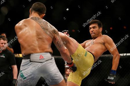 Vitor Belfort, Lyoto Machida. Lyoto Machida, from Brazil, right, kicks his countryman Vitor Belfort, during their UFC middleweight mixed martial arts bout in Rio de Janeiro, Brazil