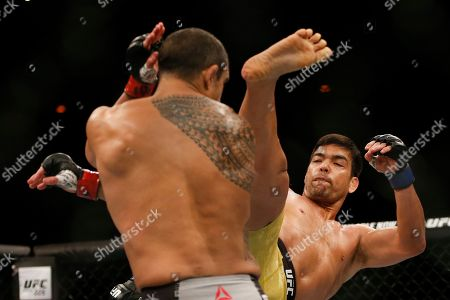 Stock Picture of Vitor Belfort, Lyoto Machida. Lyoto Machida, from Brazil, right, and his countryman Vitor Belfort, fight during their UFC middleweight mixed martial arts bout in Rio de Janeiro, Brazil