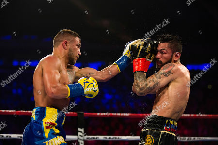 Vasiliy Lomachenko, left, of Ukraine, fights Jorge Linares, of Venezuela, during their WBA lightweight championship boxing match, in New York