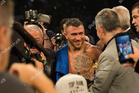 Stock Image of Vasiliy Lomachenko, of Ukraine, smiles after his victory against Jorge Linares, of Venezuela, during their WBA lightweight championship boxing match, in New York