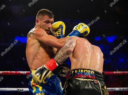 Stock Picture of Vasiliy Lomachenko, left, of Ukraine, at left, throws a right at Jorge Linares, of Venezuela, during their WBA lightweight championship boxing match, in New York