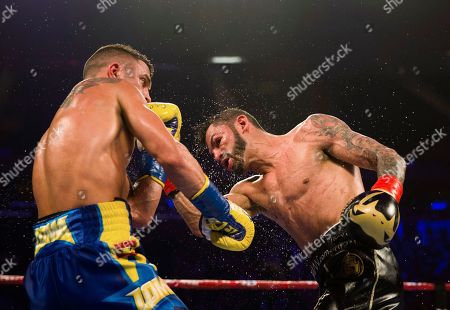 Vasiliy Lomachenko, left, of Ukraine, tries to avoid a punch from Jorge Linares, of Venezuela, during the WBA lightweight championship boxing match, in New York