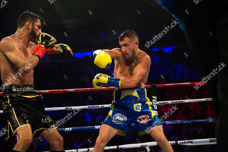 Vasiliy Lomachenko, right, of Ukraine, faces off against Jorge Linares, of Venezuela, during their WBA lightweight championship boxing match, in New York