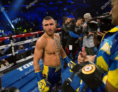 Vasiliy Lomachenko, of Ukraine, stands in the ring after his victory against Jorge Linares, of Venezuela, during the WBA lightweight championship boxing match, in New York