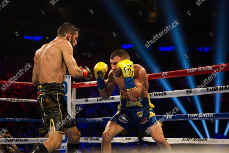 Vasiliy Lomachenko, right, of Ukraine, covers up against Jorge Linares, of Venezuela, during their WBA lightweight championship boxing match, in New York