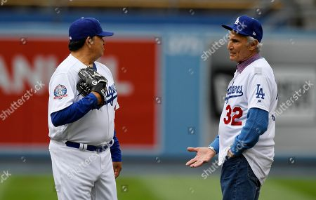 Sandy Koufax, Fernando Valenzuela. Former Los Angeles Dodgers pitchers Fernando Valenzuela, left, and Sandy Koufax talk before an Old Timers game held prior to a baseball game between the Dodgers and the Cincinnati Reds, in Los Angeles