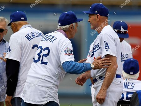 Sandy Koufax, Kirk Gibson, Don Newcombe. Former Los Angeles Dodgers pitcher Sandy Koufax, center, talks to Kirk Gibson, right, as Don Newcombe stands nearby before an Old Timers game held before a baseball game between the Dodgers and the Cincinnati Reds, in Los Angeles