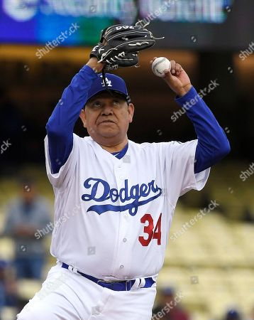 Former Los Angeles Dodgers pitcher Fernando Valenzuela winds up during an Old Timers game held prior to a baseball game between the Dodgers and the Cincinnati Reds, in Los Angeles