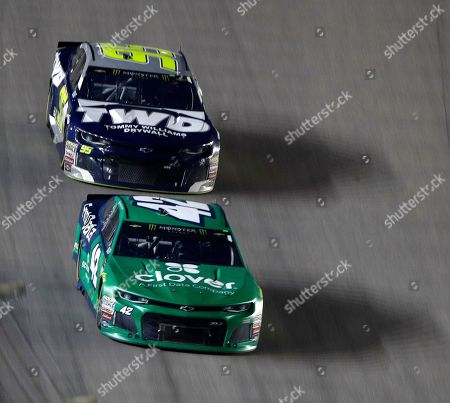 Kyle Larson (42) leads the pack after lapping Kasey Kahne (95) during the NASCAR Cup Series auto race at Kansas Speedway, in Kansas City, Kan