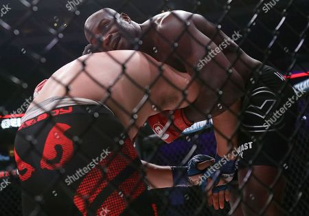 Cheick Kongo, top, fights Javy Ayala during a heavyweight mixed martial arts fight at Bellator 199 in San Jose, Calif., . Kongo won the fight