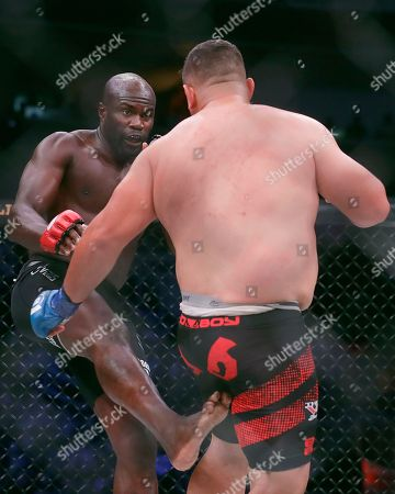 Cheick Kongo, left, kicks Javy Ayala during a heavyweight mixed martial arts fight at Bellator 199 in San Jose, Calif., . Kongo won the fight