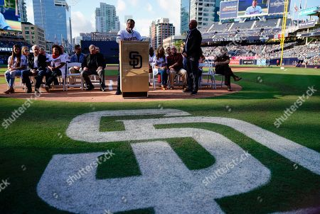 Former San Diego Padres relief pitcher Trevor Hoffman speaks to the crowd with the 1998 National League Championship team to induct former Padres General Manager Kevin Towers into the Padres Hall of Fame, prior to the Padres' baseball game against the St. Louis Cardinals in San Diego