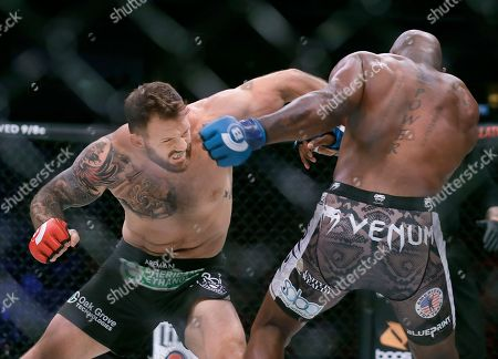 """Ryan Bader, Muhammed """"King Mo"""" Lawal. Ryan Bader, left, punches Muhammed Lawal during a heavyweight mixed martial arts fight at Bellator 199 in San Jose, Calif., . Bader won the fight by knockout in the first round"""