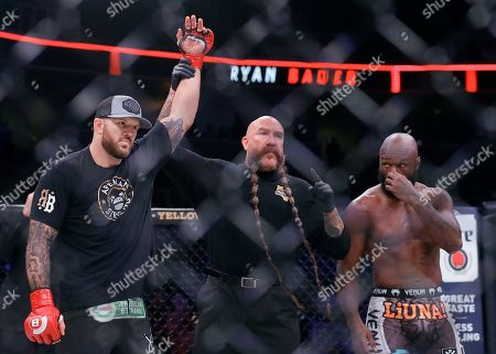 """Ryan Bader, Muhammed """"King Mo"""" Lawal. Ryan Bader, left, has his arm raised by referee Mike Beltran after defeating Muhammed Lawal, right, during a heavyweight mixed martial arts fight at Bellator 199 in San Jose, Calif., . Bader won the fight by knockout in the first round"""