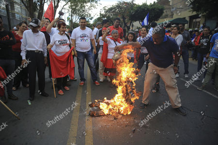 Supporters of former President of Honduras Manuel Zelaya protest against the suspension of Temporary Protected Status (TPS) in front of the US embassy in Tegucigalpa, Honduras, 12 May 2018. Former President Manuel Zelaya led a march of hundreds of people against the suspension of the Temporary Protected Status (TPS) for thousands of Hondurans living in the United States.