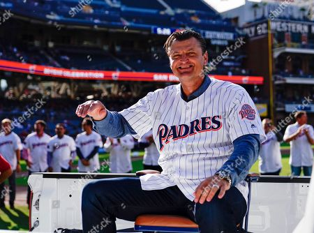 Former San Diego Padres relief pitcher Trevor Hoffman is introduced with the 1998 National League Championship team to induct former Padres General Manager Kevin Towers into the Padres Hall of Fame, prior to the Padre's baseball game against the St. Louis Cardinals in San Diego