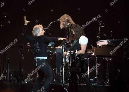 Jon Bon Jovi with guitarist Phil X and keyboardist David Bryan
