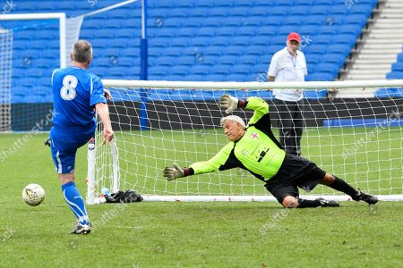 Riccardo Brustia of Italy over 60's misses the target as his penalty attempt goes wide as John Sykes of England over 60's dives during the world's first Walking Football International match