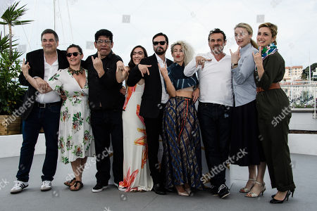 (L-R) Producers Jean-Raymond Garcia, Agustina Llambi-Campbell, actor Victor Lopez, actress Tania Casciani, director Alejandro Fadel, actress Romina Iniesta, actor Stephane Rideau and producers Nadia Turincev and Julie Gayet pose during the photocall for 'Murder me, Moster (Muere, Monstruo, Muere)' at the 71st annual Cannes Film Festival, in Cannes, France, 13 May 2018. The movie is presented in the section Un Certain Regard of the festival which runs from 08 to 19 May.
