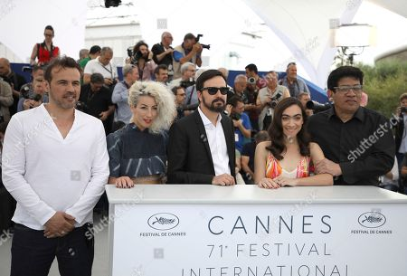 Stephane Rideau, Romina Iniesta, Alejandro Fadel, Tania Casciani, Victor Lopez. Actor Stephane Rideau, from left, actress Romina Iniesta, director Alejandro Fadel, actress Tania Casciani, and actor Victor Lopez pose for photographers during a photo call for the film '3 Faces' at the 71st international film festival, Cannes, southern France