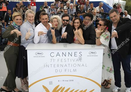 Julie Gayet, Nadia Turincev, Stephane Rideau, Romina Iniesta, Alejandro Fadel,Tania Casciani, Victor Lopez, Agustina Llambi-Campbell, ean-Raymond Garcia. Producer Julie Gayet, from left, producer Nadia Turincev, actor Stephane Rideau, actress Romina Iniesta, director Alejandro Fadel, actress Tania Casciani, actor Victor Lopez, producer Agustina Llambi-Campbell and producer Jean-Raymond Garcia pose for photographers during a photo call for the film '3 Faces' at the 71st international film festival, Cannes, southern France