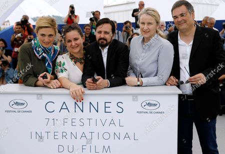 Director Alejandro Fadel (C) poses with producers Julie Gayet (L), Agustina Llambi-Campbell (2-L), Nadia Turincev (4-L) and Jean-Raymond Garcia (R) pose during the photocall for 'Murder me, Moster (Muere, Monstruo, Muere)' at the 71st annual Cannes Film Festival, in Cannes, France, 13 May 2018. The movie is presented in the section Un Certain Regard of the festival which runs from 08 to 19 May.