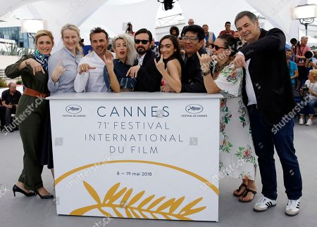 (R-L) Producers Jean-Raymond Garcia, Agustina Llambi-Campbell, actor Victor Lopez, actress Tania Casciani, director Alejandro Fadel, actress Romina Iniesta, actor Stephane Rideau and producers Nadia Turincev and Julie Gayet pose during the photocall for 'Murder me, Moster (Muere, Monstruo, Muere)' at the 71st annual Cannes Film Festival, in Cannes, France, 13 May 2018. The movie is presented in the section Un Certain Regard of the festival which runs from 08 to 19 May.
