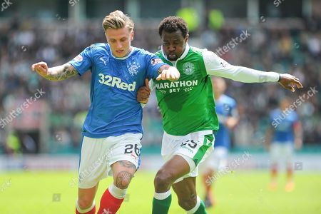 Former team mates Jason Cummings and Efe Ambrose clash during the Ladbrokes Scottish Premiership match between Hibernian and Rangers at Easter Road, Edinburgh. Picture by Kevin Murray