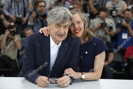 Wim Wenders, Donata Wenders. Director Wim Wenders, left, and Donata Wenders pose for photographers during a photo call for the film 'Pope Francis: A Man of His Word' at the 71st international film festival, Cannes, southern France