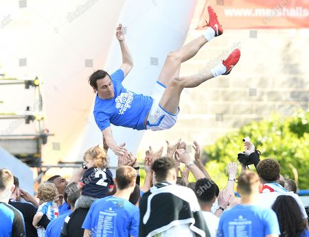 Dean Whitehead of Huddersfield Town is thrown into the air by his team-mates
