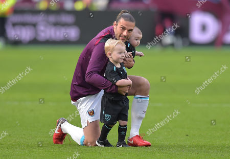 Andy Carroll of West Ham United takes a lap of honour with his children