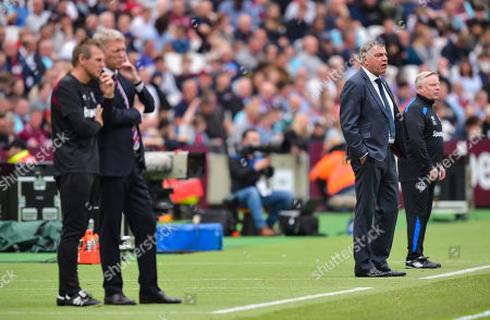 West Ham United Manager David Moyes with assistant Stuart Pearce and Everton manager Sam Allardyce with assistant Sammy Lee