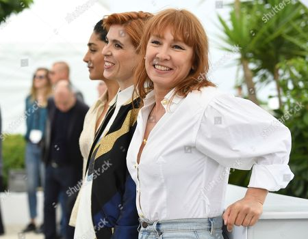 Emmanuelle Bercot, Eva Husson, Golshifteh Farahani. Actress Golshifteh Farahani, from left, director Eva Husson and actress Emmanuelle Bercot pose for photographers during a photo call for the film 'Girls of The Sun' at the 71st international film festival, Cannes, southern France