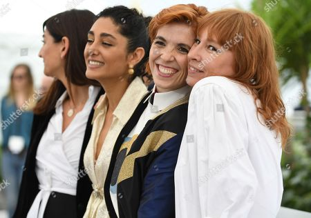 Emmanuelle Bercot, Eva Husson, Golshifteh Farahani, Didar Domehri. Producer Didar Domehri, from left, Golshifteh Farahani, director Eva Husson and Emmanuelle Bercot pose for photographers during a photo call for the film 'Girls of The Sun' at the 71st international film festival, Cannes, southern France
