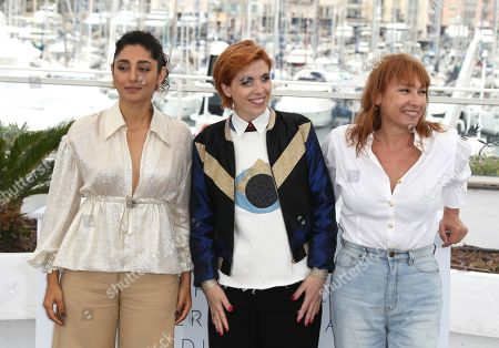 Golshifteh Farahani, Eva Husson, Emmanuelle Bercot. Actress Golshifteh Farahani, from left, director Eva Husson and actress Emmanuelle Bercot pose for photographers during a photo call for the film 'Girls of The Sun' at the 71st international film festival, Cannes, southern France