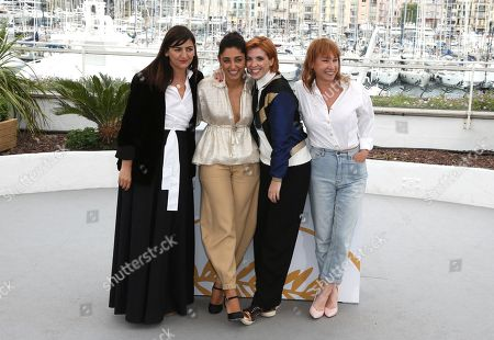 Stock Image of Didar Domehri, Golshifteh Farahani, Eva Husson, Emmanuelle Bercot. Producer Didar Domehri, from left, actress Golshifteh Farahani, director Eva Husson and actress Emmanuelle Bercot pose for photographers during a photo call for the film 'Girls of The Sun' at the 71st international film festival, Cannes, southern France
