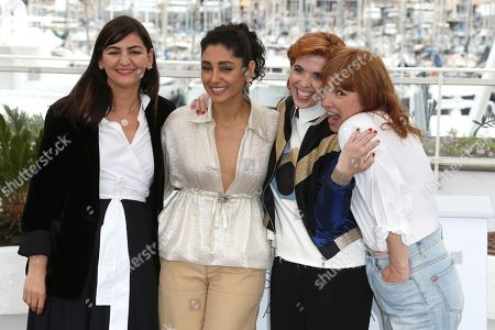 Didar Domehri, Golshifteh Farahani, Eva Husson, Emmanuelle Bercot. Producer Didar Domehri, from left, actress Golshifteh Farahani, director Eva Husson and actress Emmanuelle Bercot pose for photographers during a photo call for the film 'Girls of The Sun' at the 71st international film festival, Cannes, southern France