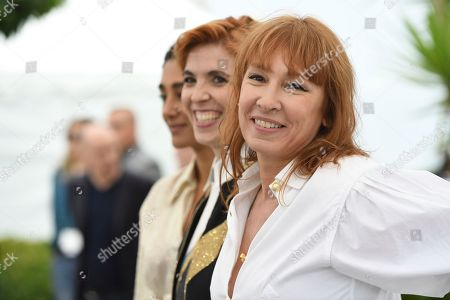 Stock Picture of Emmanuelle Bercot, Eva Husson, Golshifteh Farahani, Didar Domehri. Actress Golshifteh Farahani, from left, director Eva Husson and actress Emmanuelle Bercot pose for photographers during a photo call for the film 'Girls of The Sun' at the 71st international film festival, Cannes, southern France