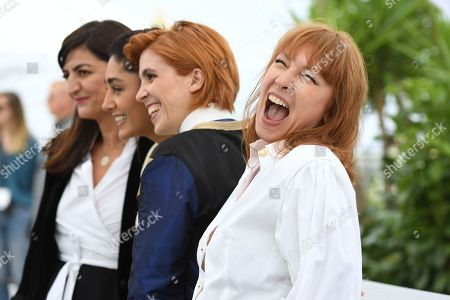 Stock Photo of Emmanuelle Bercot, Eva Husson, Golshifteh Farahani, Didar Domehri. Producer Didar Domehri, from left, actress Golshifteh Farahani, director Eva Husson and actress Emmanuelle Bercot pose for photographers during a photo call for the film 'Girls of The Sun' at the 71st international film festival, Cannes, southern France